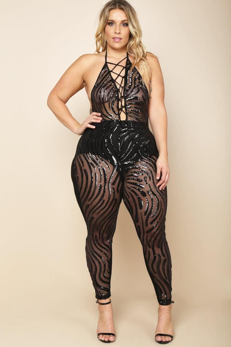 402997283042c A plus size sleeveless jumpsuit with a lace up halter neckline. Features a  cinched waistline and sequin details. Sheer mesh all over.