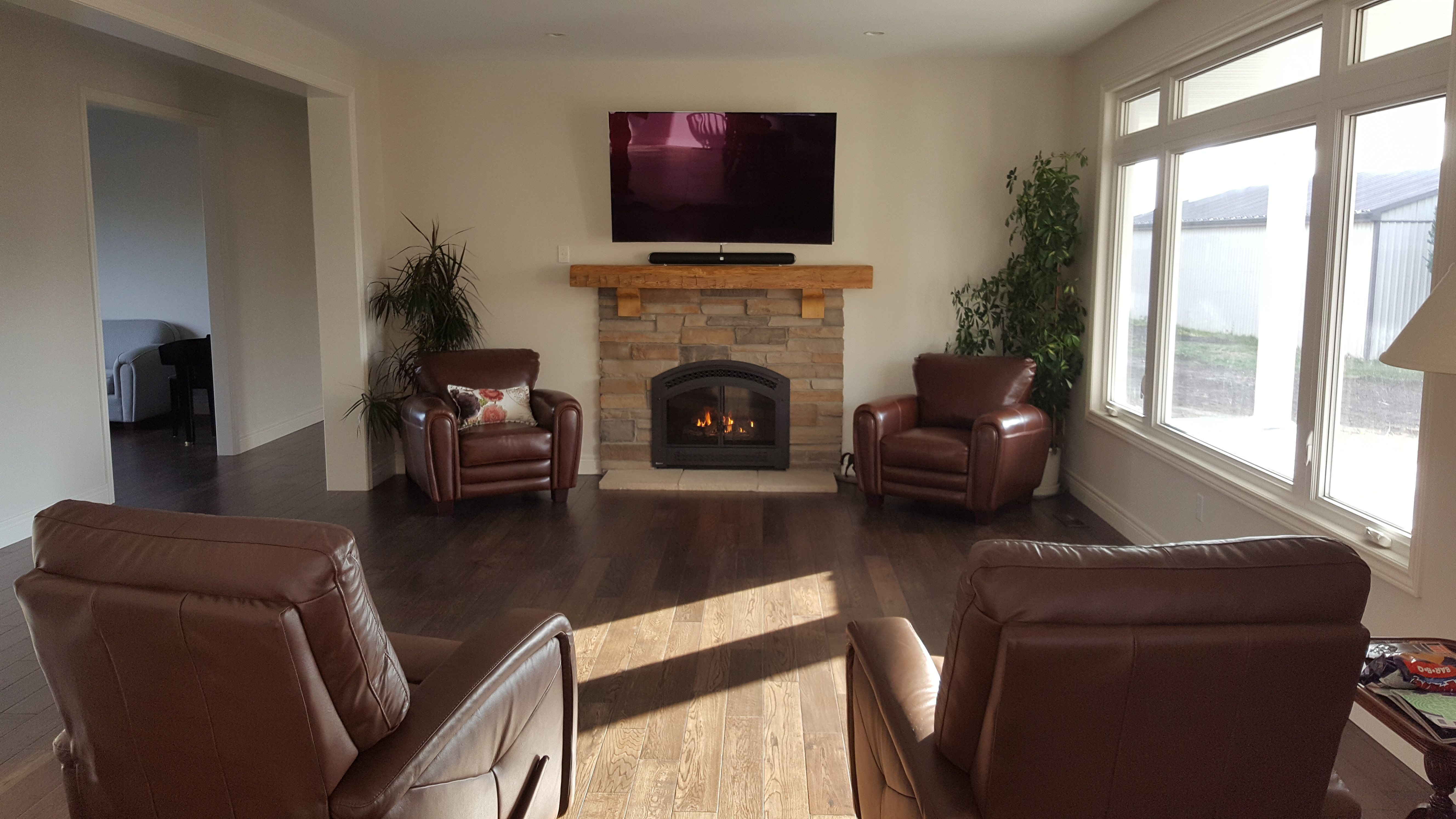 cultured stone fireplace surround with rustic mantle and kentwood