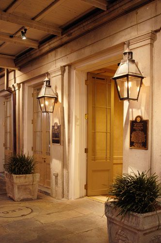 Classic New Orleans Gas Lanterns And French Doors Porch