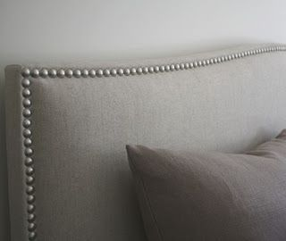 Padded bedhead has been upholstered in grey 100% linen fabric sold at Bedhead Design