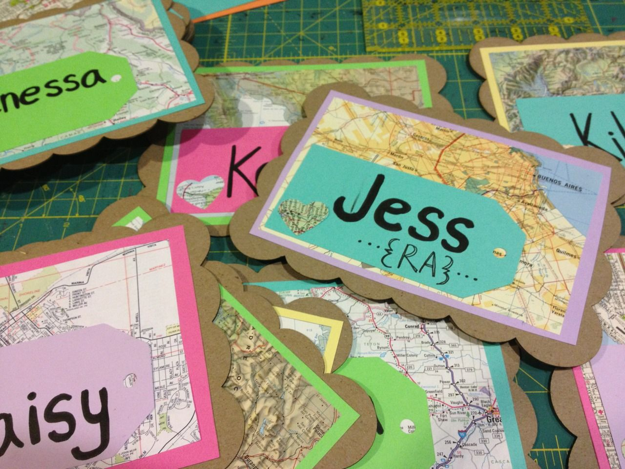 Door Dec Cut maps into small squares luggage tags with names glued on brown & Door Dec: Cut maps into small squares luggage tags with names ...