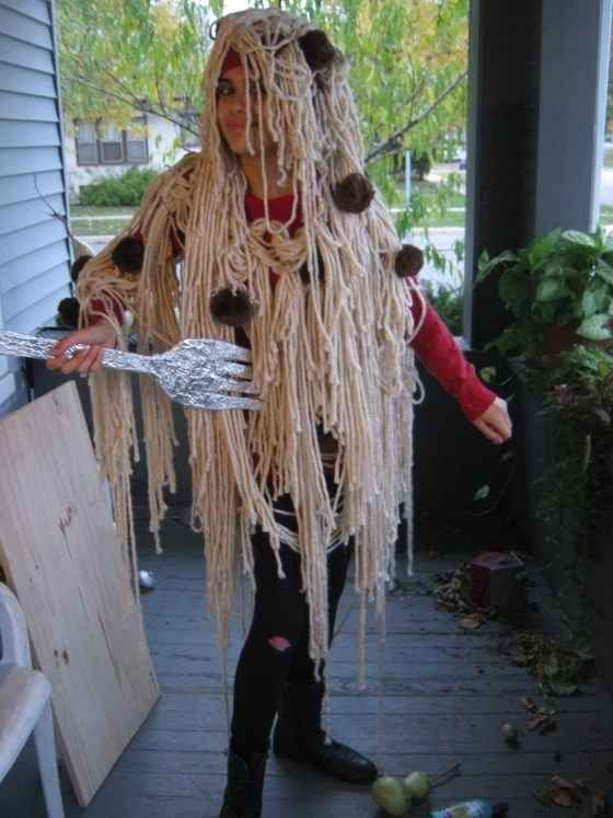 Glue beige yarn and brown pom-poms onto a hoodie to go as spaghetti and meatballs.