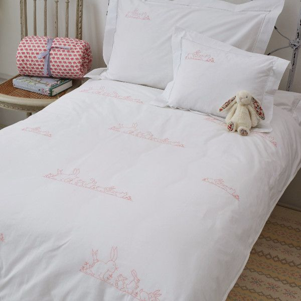 Crisp white cotton duvet cover hand embroidered with a charming rabbit design. Also available in blue. 140cm x 200cm 100%...