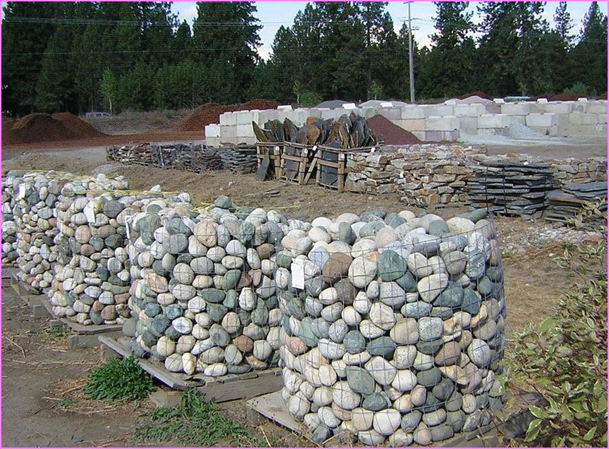 landscaping with river rock on a hill - front yard ...