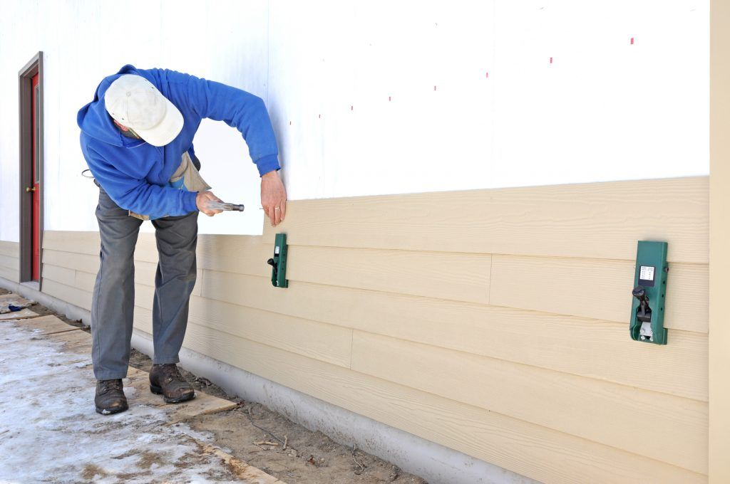 Should You Install A Housewrap Before Siding Modernize Housewrap Installing Siding Vinyl Siding Installation