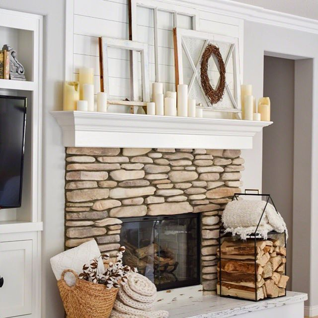fireplace decor, shiplap fireplace, neutral decor, stone fireplace, large hearth, rustic fireplace, farmhouse style fireplace, fireplace, vintage windows. mantle decor, vintage decor, candles, white candles