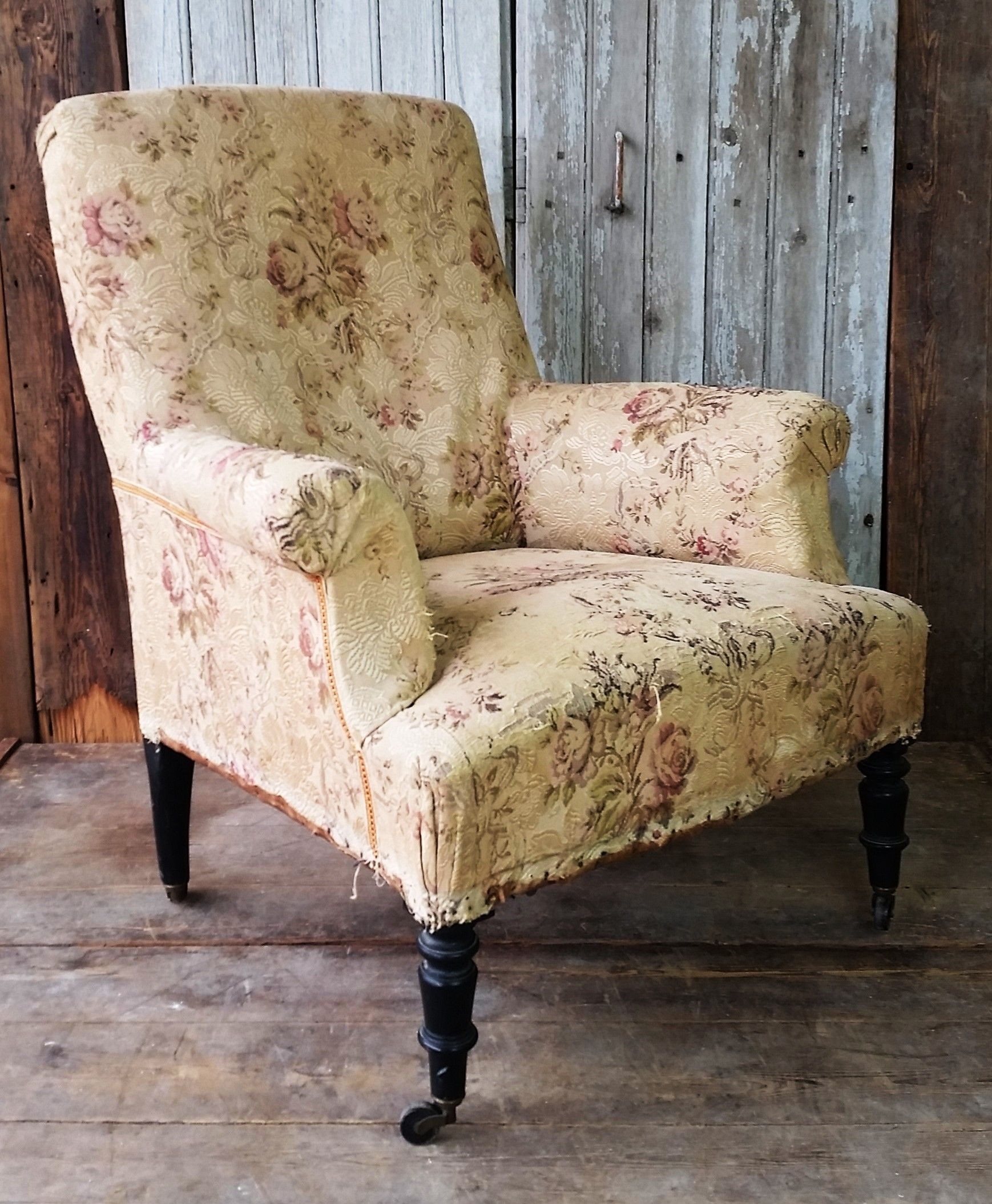 French antique chair with worn original upholstery.