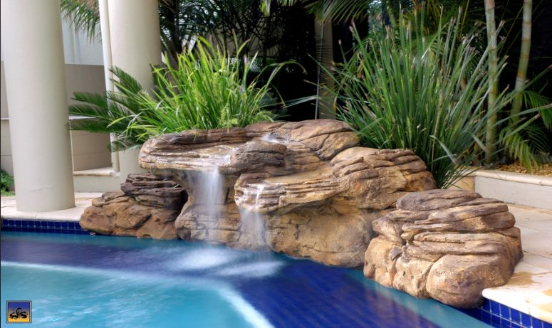 Poly Resin Rock This Product Is Rock Pieces Held With A Mesh And Resin Polyurethane Not He Backyard Pool Landscaping Pool Waterfall Swimming Pool Waterfall
