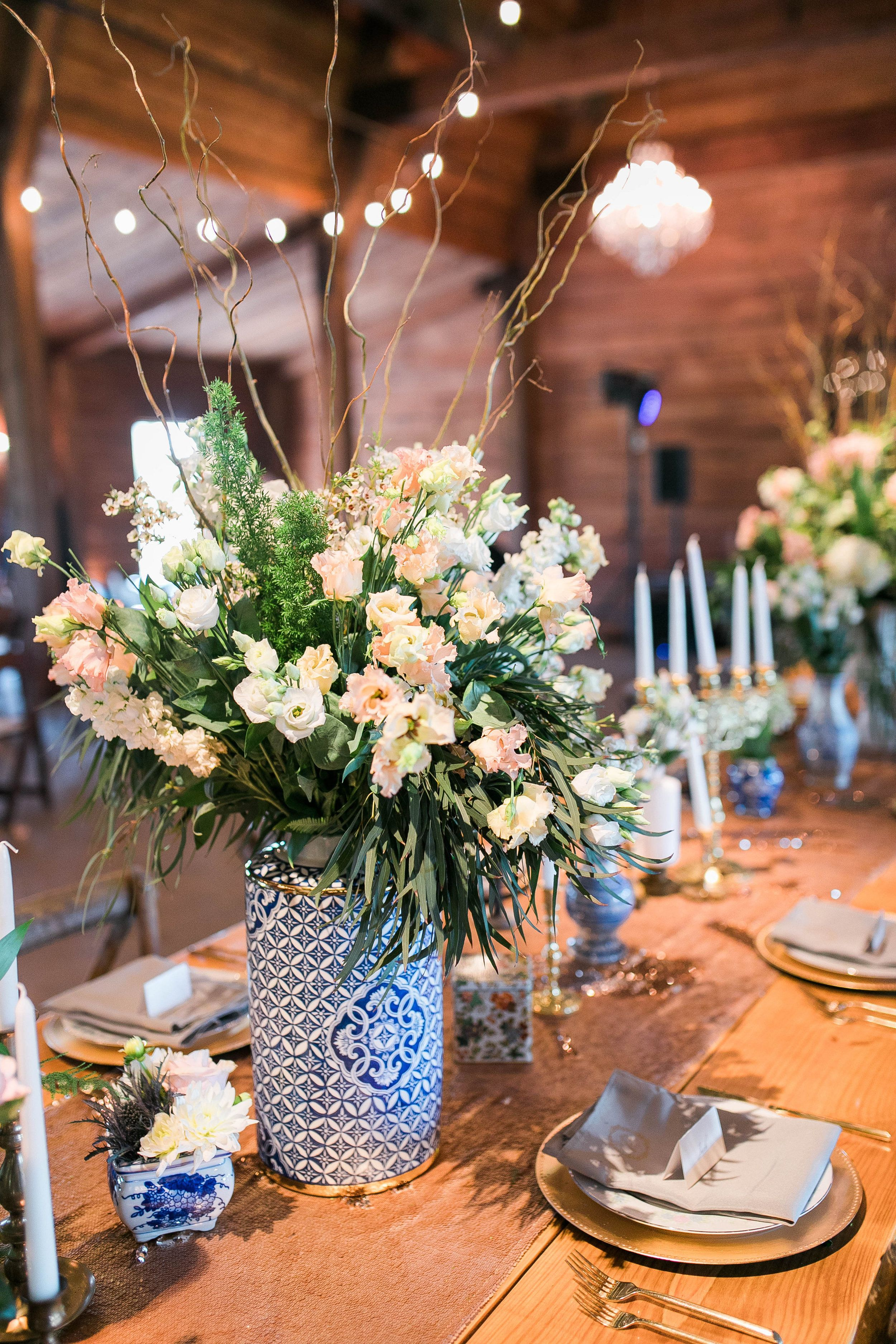 Reception With Settee Table Numbers Brass Candles Mismatched China Romantic Barn Wedding By Rent My D Diy Wedding Decorations Barn Wedding Farm Wedding