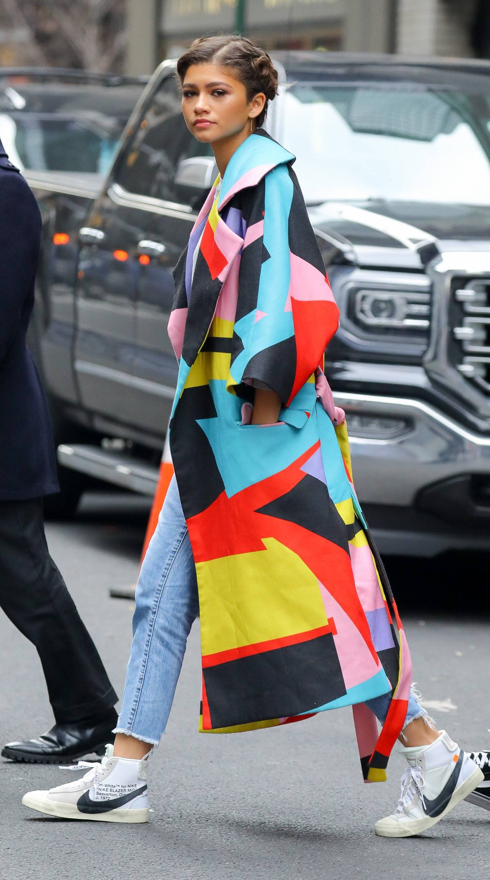 Zendaya wore a Maria Escoté Spring 2018 colorblock graphic coat while  taping an appearance on