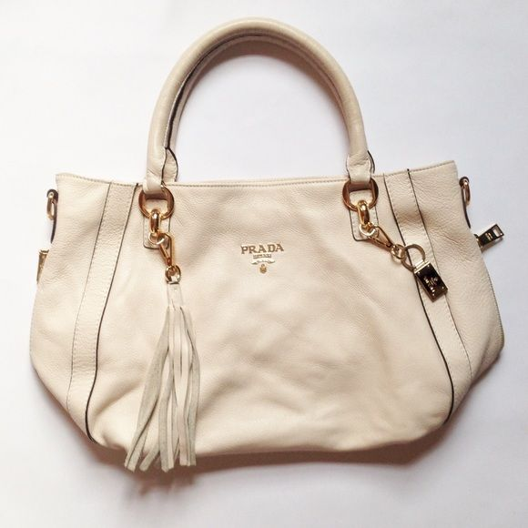 c6b4b4e67c6d Cream Prada Purse Beautiful cream Prada bag in perfect condition. Older  style that was only worn a few times. Leather is pristine and buttery. All  key ...