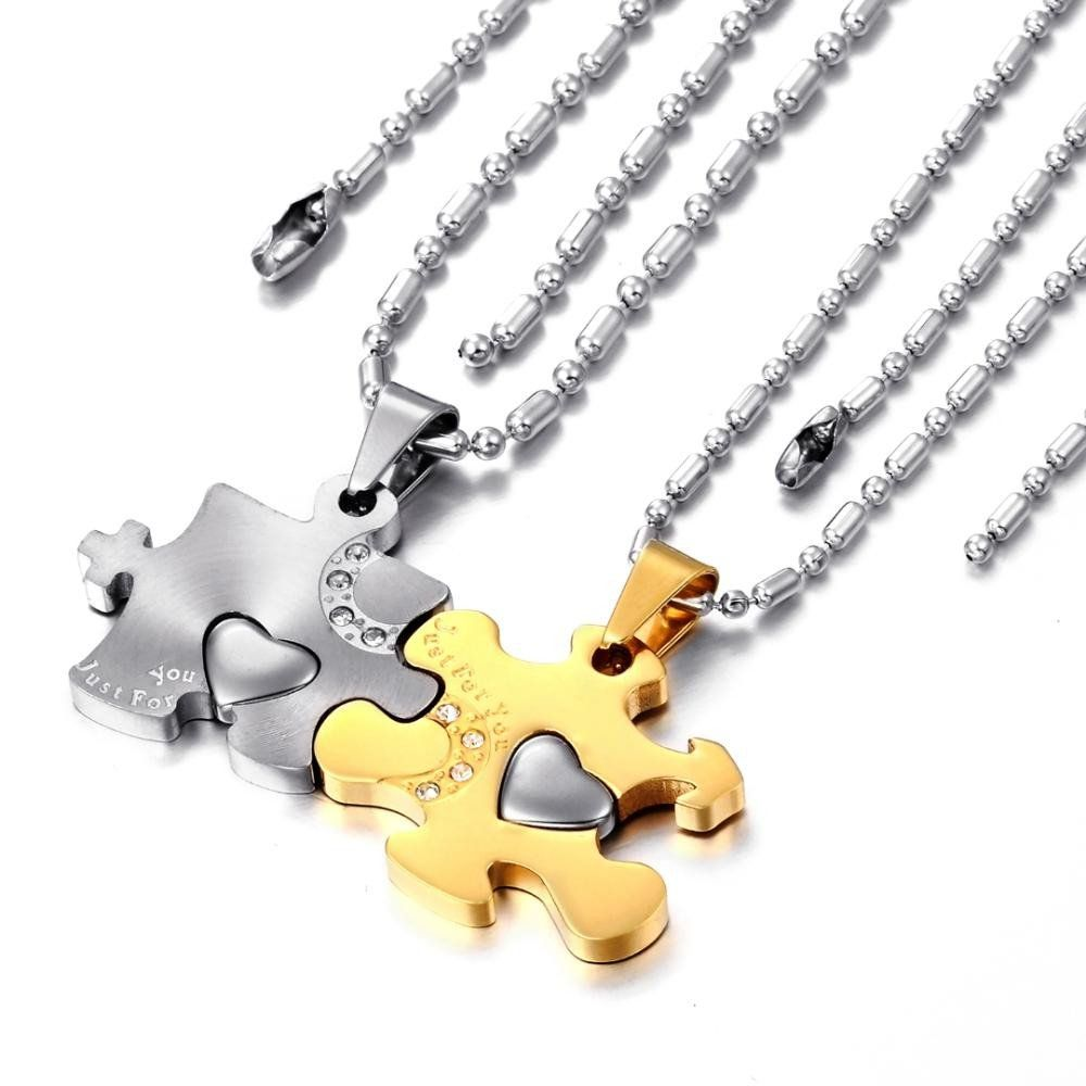 Couple's Puzzle Pieces Necklaces Set.   Lovers fit together like pieces of a puzzle.  Show how perfectly you fit together with this necklace set.