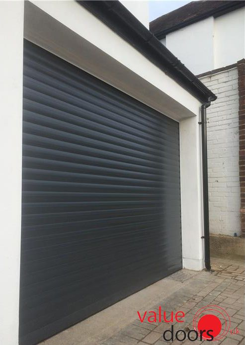 Roller Shutter Garage Door In Black Garage Doors Garage Door