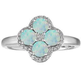 Opal Birthstone Diamond Clover Ring In Sterling Silver Gemologica.com offers a large selection of custom gemstone and birthstone rings available in Sterling Silver, 10K, 14K and 18K yellow, rose and white gold. Our gemstone rings are available in many styles, including engagement, antique style, promise, right hand, stackable, couples and mothers rings. Gemstone jewelry rings can be found on our website here: www.gemologica.com/gemstone-rings-c-27_49.html