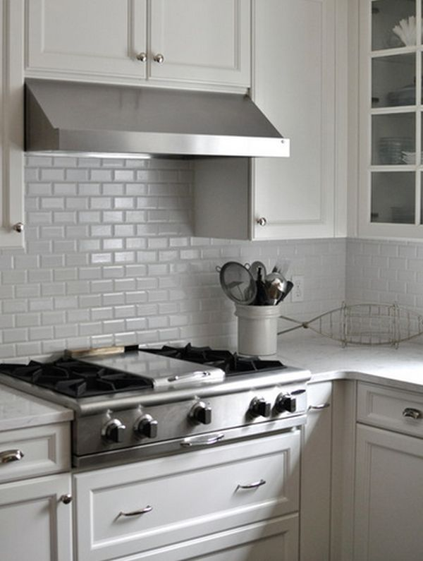 Captivating A Traditional Kitchen Showcasing A White Backsplash And Matching Cabinets