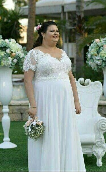 plus size real bride in studio levana scarlet gown with short
