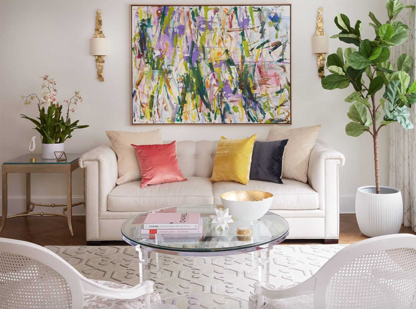 cozy transitional style white living room with colorful