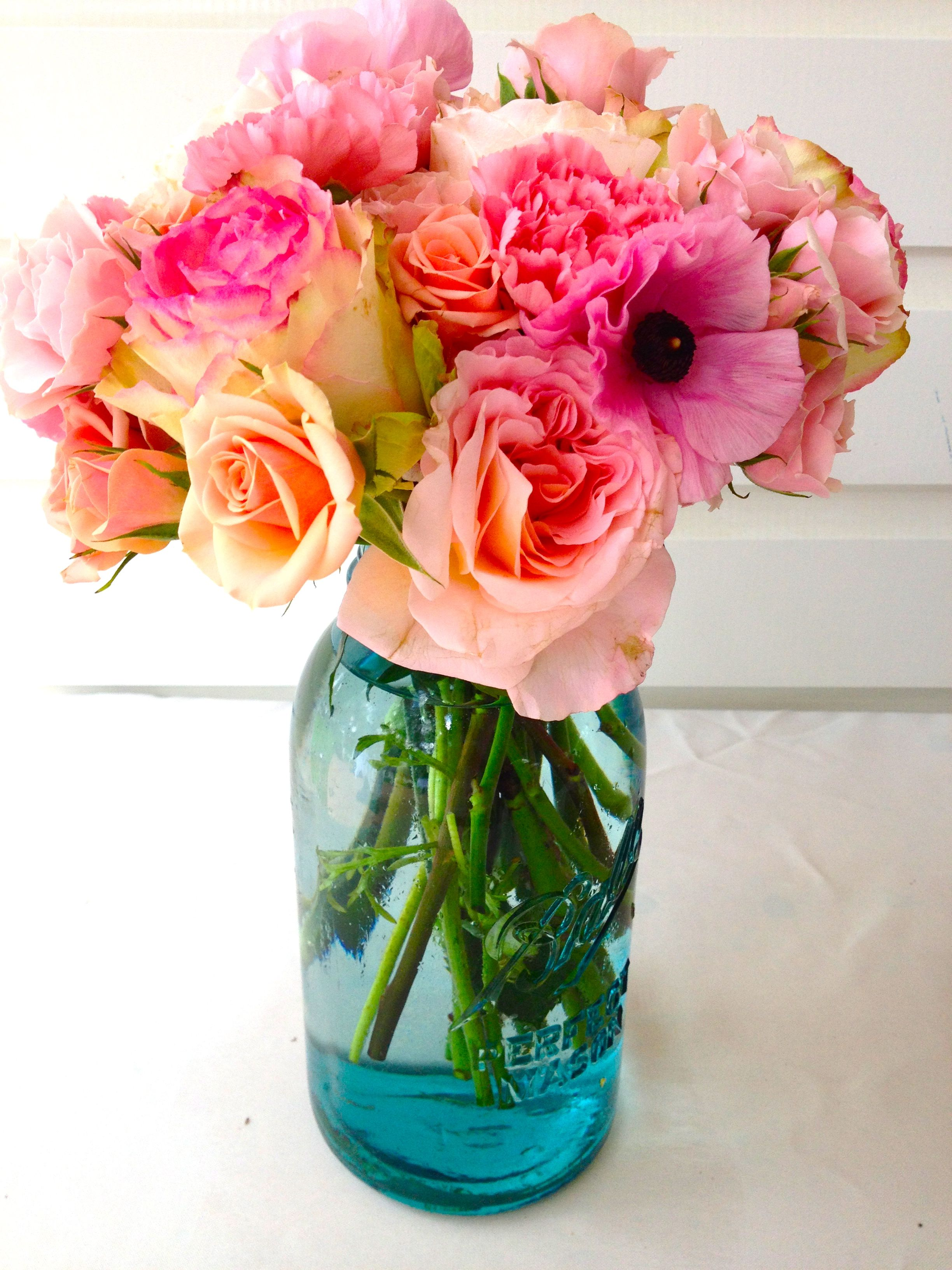 this gorgeous flower arrangement compliments the cool hues of the