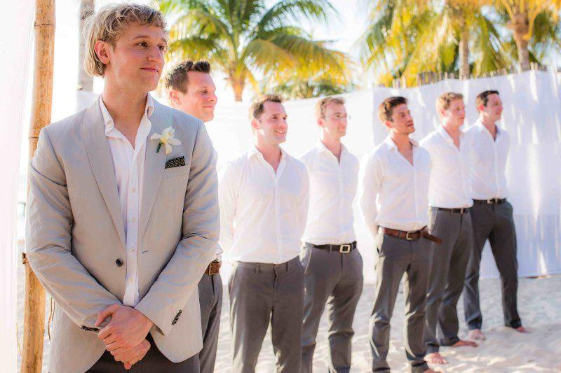 Groomsmen beach wedding attire. Gray pants, white button ups. Photo ...