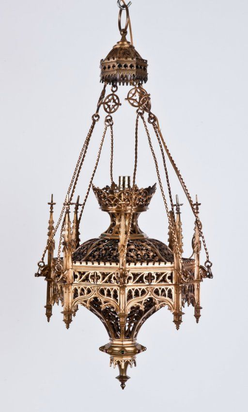 Early 20th Century Gothic Revival Octagonal Shaped Bronze Chandelier - suspended from twisted bronze supports each held in place by a gargoyle, surmounted by Gothic spires, with finely detailed tracery designs throughout.