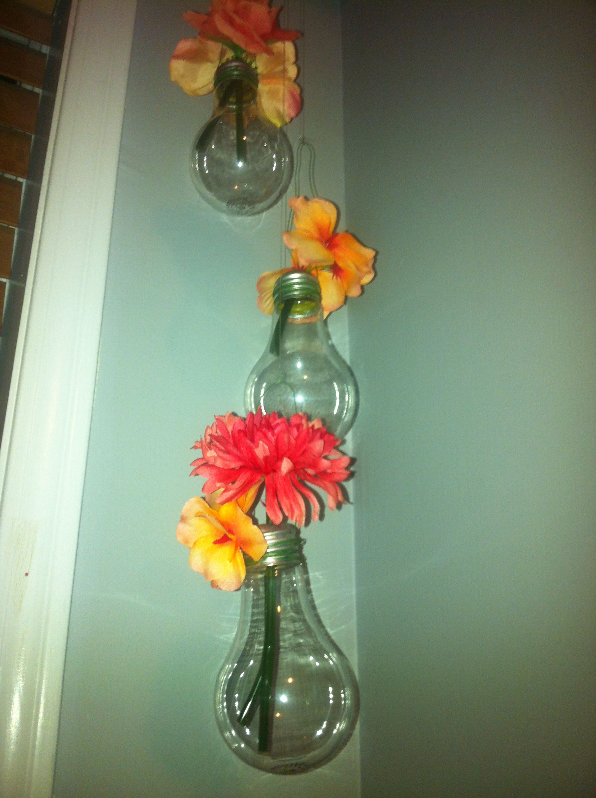 Re-used light bulbs to make hanging vases