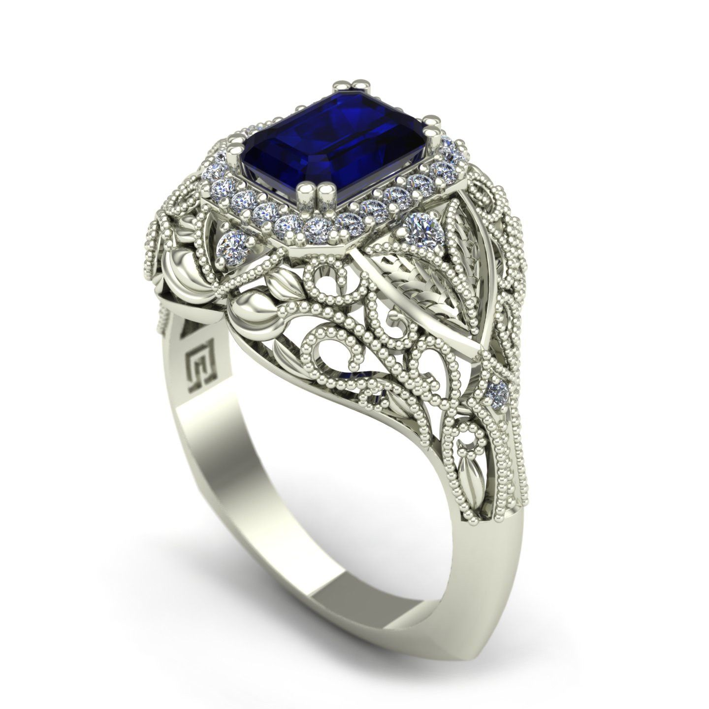 An Emerald Cut Blue Sapphire Is Set In A Halo Of Diamonds And Surrounded By Scrolls Vines Leaves This White Gold Vintage Style Cocktail Ring