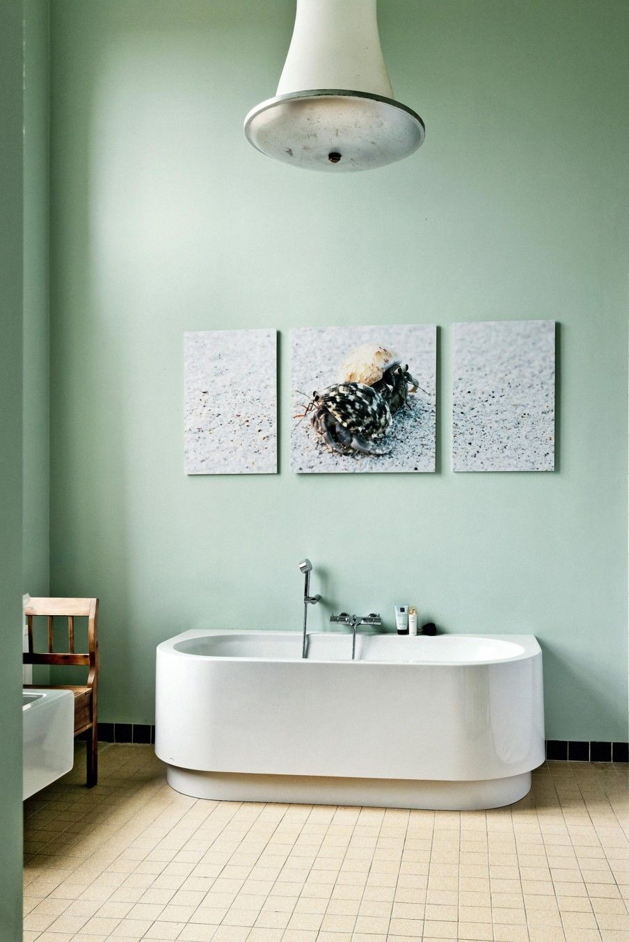Bathroom with a green wall and freestanding bath | Styling Kim van ...