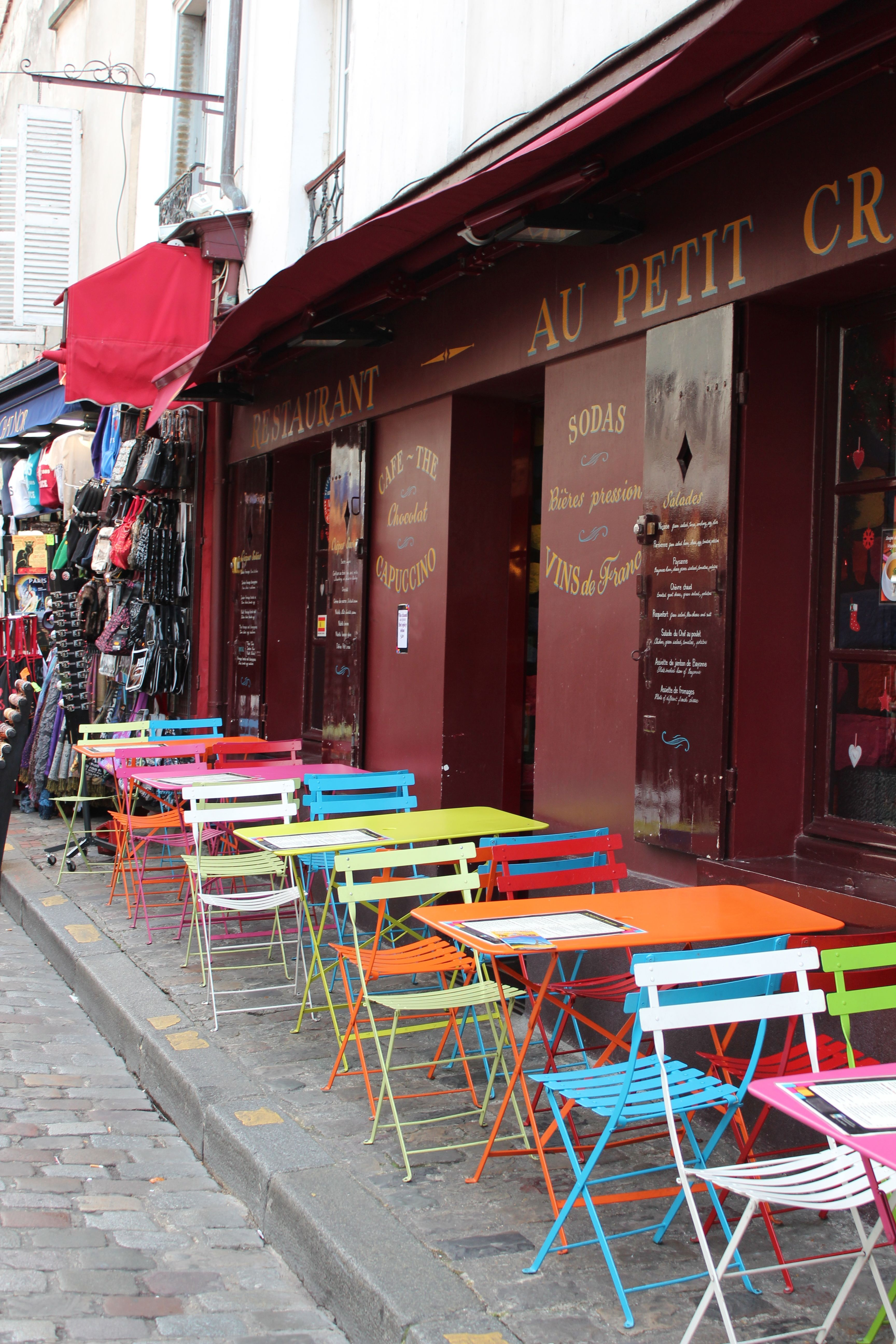 Paris cafe - love the colourful table and chairs