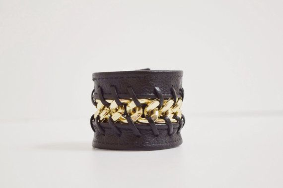 Leather and gold chain are laced together to form a beautiful - statement form