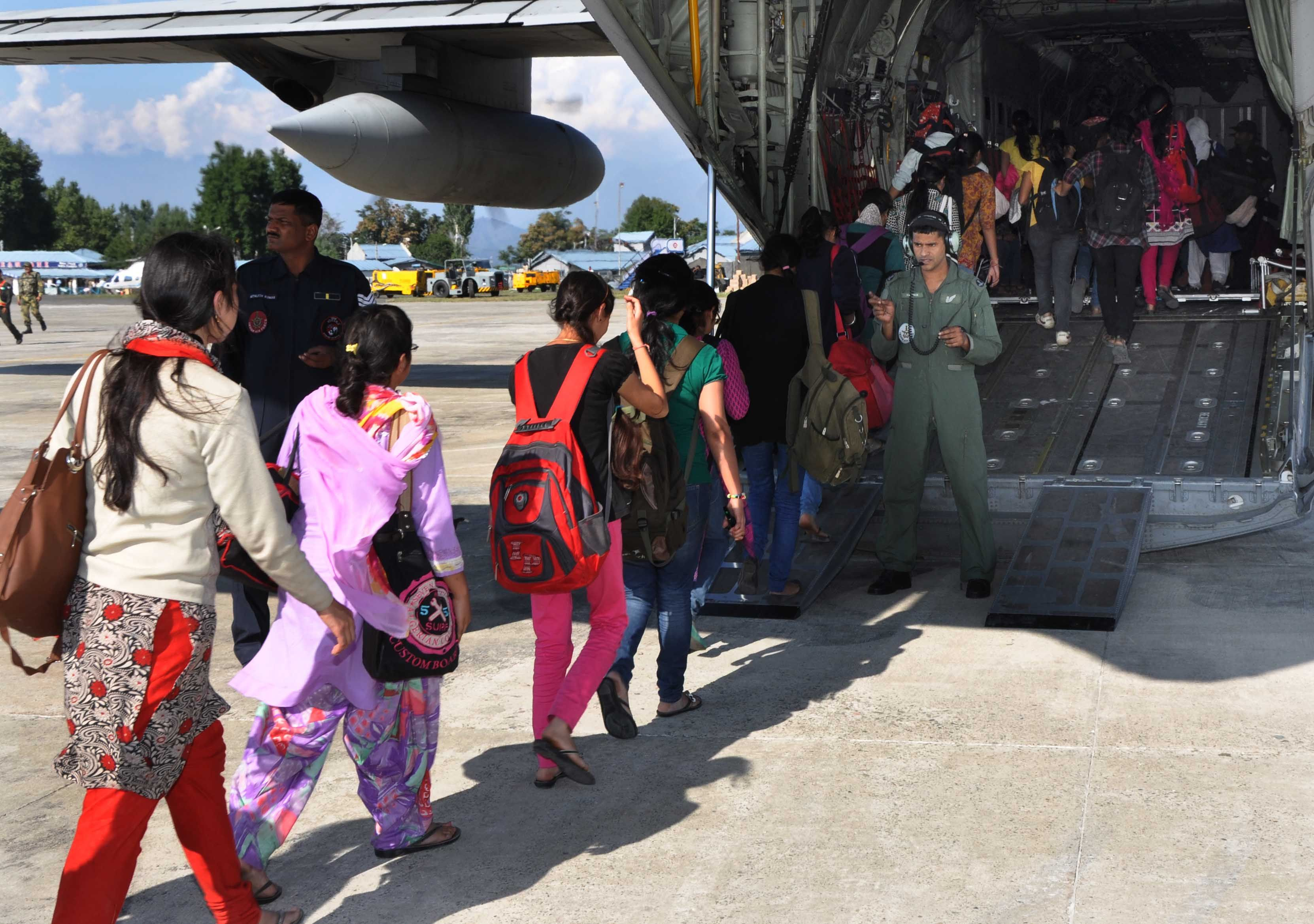 Stranded students rescued and being taken in an IAF Super Hercules C130J at Air Force Station Srinagar on 13 September 2014.