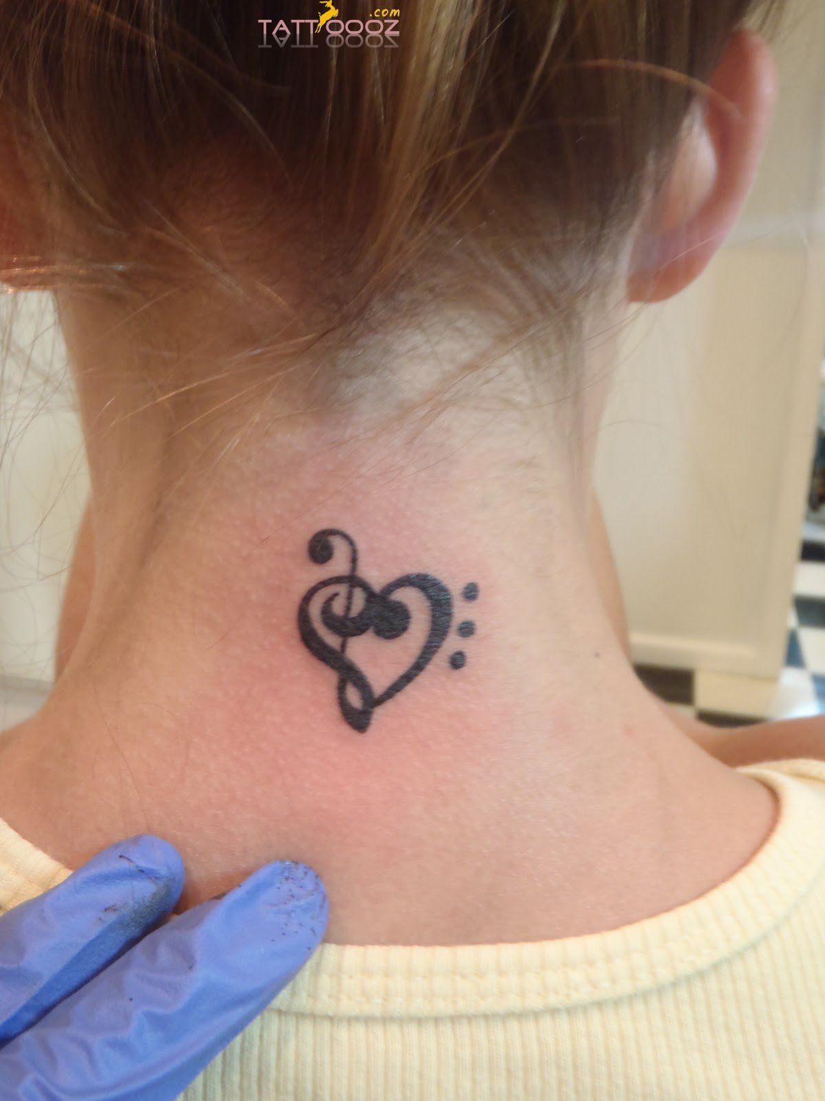 Treble and Bass Cleff Heart Tattoo