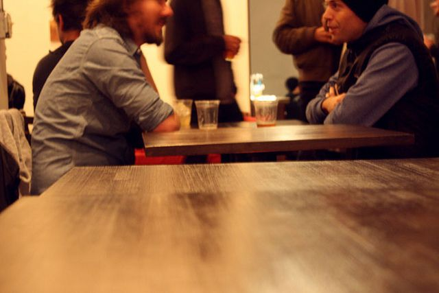 Best part of this is hte persepctive of the shot.  Love it.  Plus, I like the masculine edge of the context to the picture with the dudes talking.    Candid Coffeeshop Conversation by RiottBaby, via Flickr