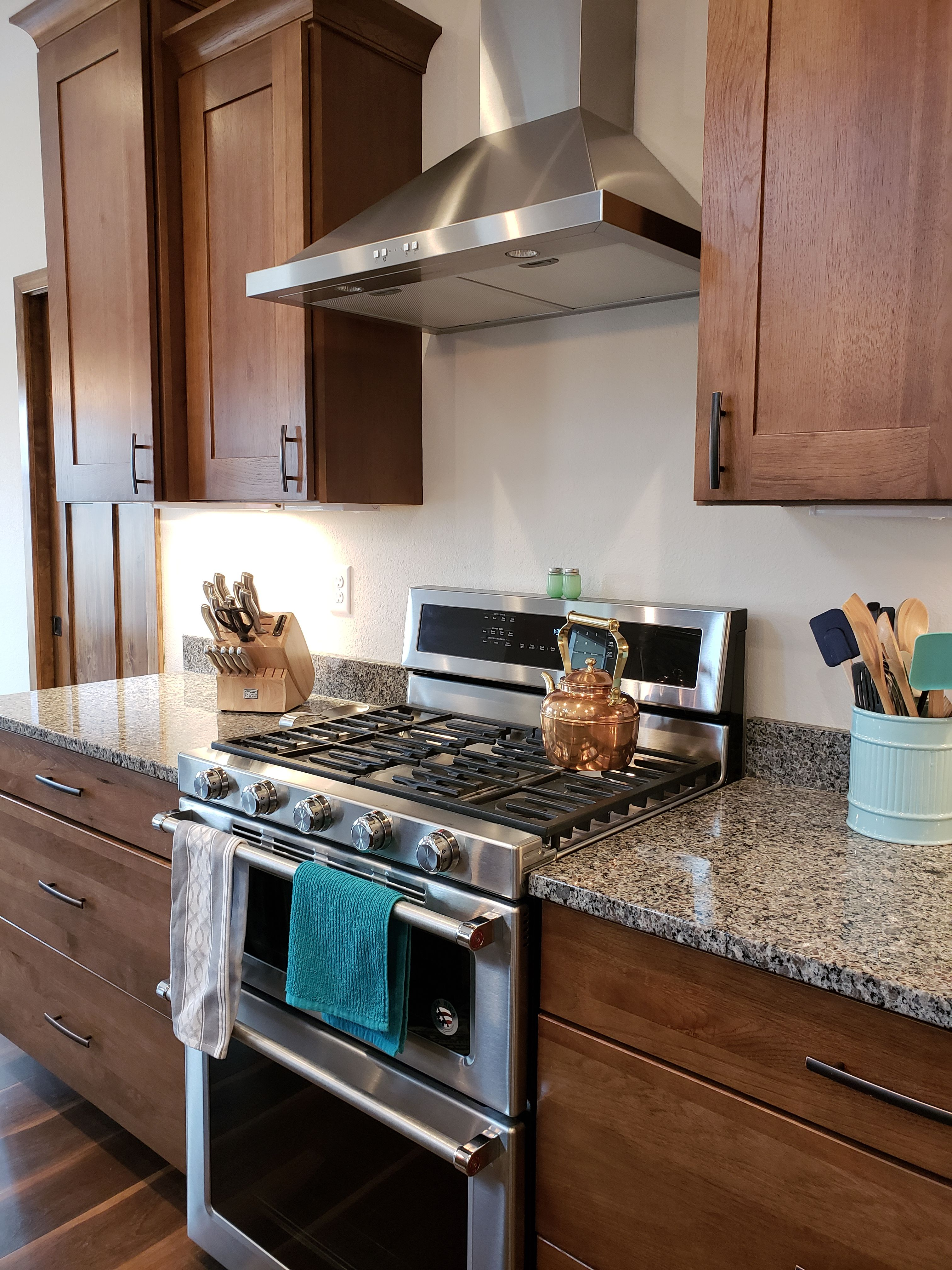 Gas range with stainless steel hood vent in new