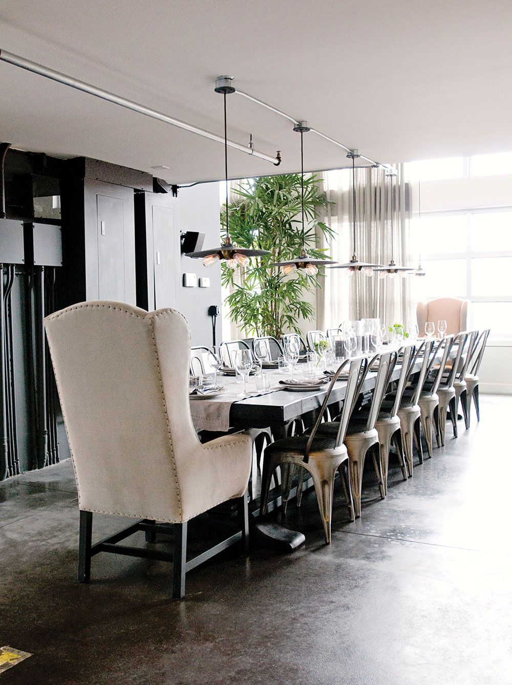 The 16 Foot Dining Table, Surrounded By Stackable French Cafe Chairs By Restoration  Hardware.