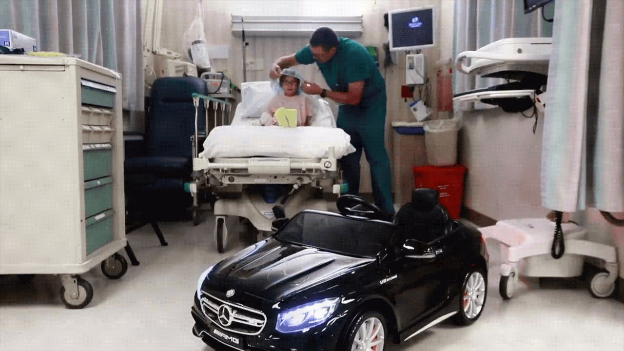 Pediatric patient drives a toy car into surgery