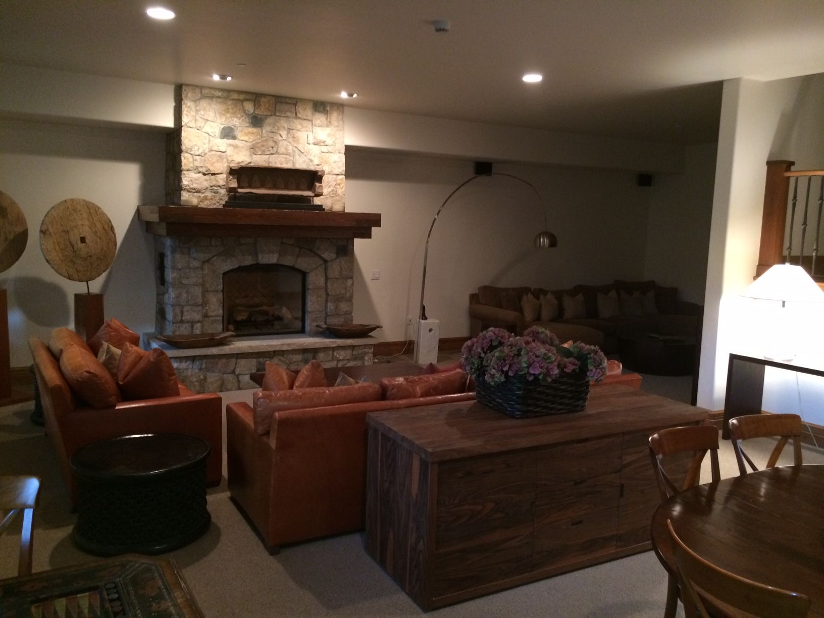 Lower level fireplace, hot tub, living space and bedrooms