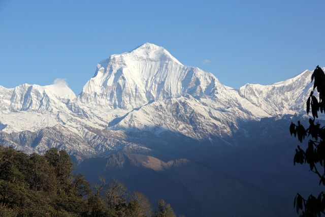 A day by day guide to hiking the beautiful Ghorepani Poon Hill trek in the Annapurna Himalaya range near Pokhara, Nepal!