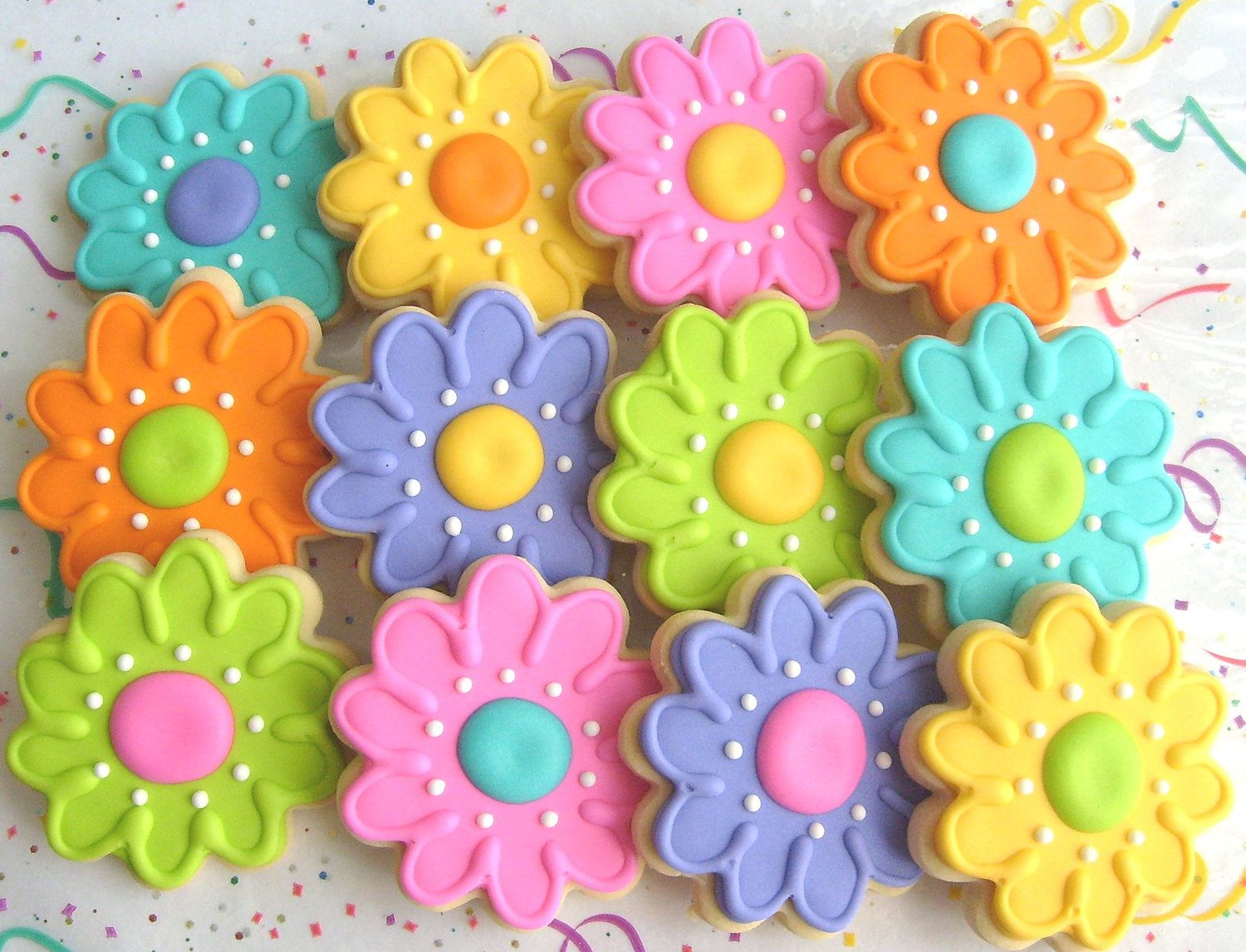 This listing is reserved!  Will re list :0)      36 - Flower cookies    Assorted Bright colors    To be shipped May 6th    Thanks Heidi!                                          Spring is almost here......but until then, wouldnt you  love to have a Flower Garden thats nice to look at  and tastes good too!    These Flowers are Hand Cut & Decorated!  Made with our Signature Shortbread dough!  They are 3 1/4 in size!    This listing is for 1 DOZEN!    Each cookie is individually package...
