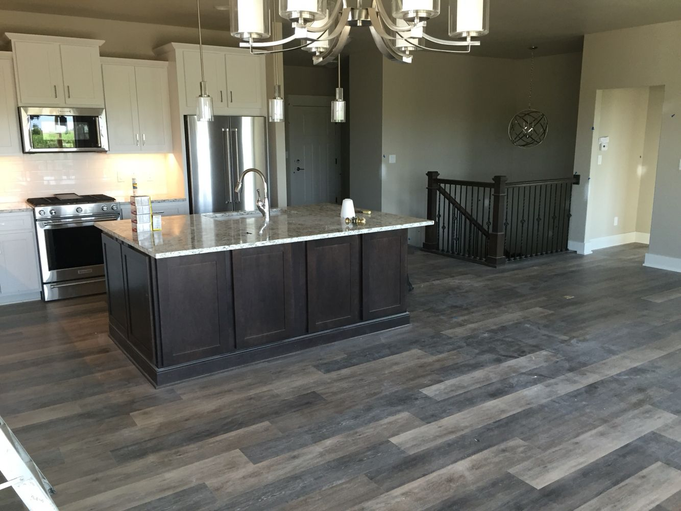 Remodeling for a Fireplace Laminate flooring in kitchen