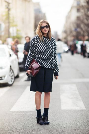 25 Ways to Wear Midi Skirts - black and white sweater worn with a black midi skirt + oxblood clutch and socks + mules | StyleCaster