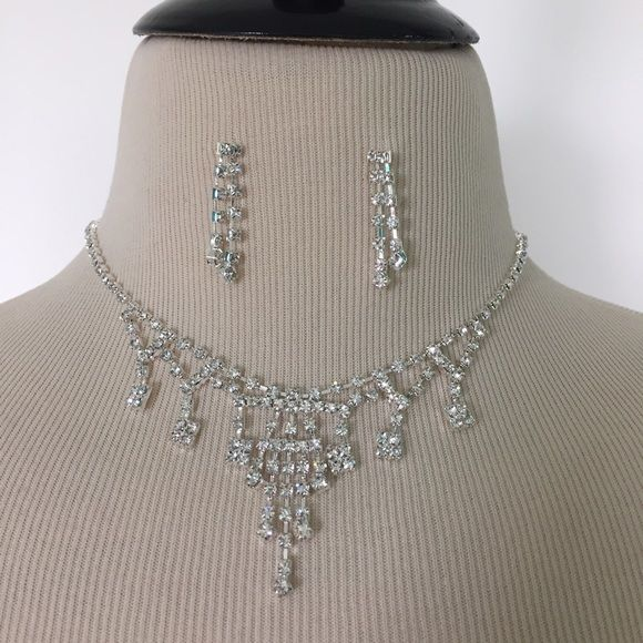 """NEW Faux Diamond Crystal Statement Necklace Set This NEW """"crystal"""" necklace set is absolutely gorgeous! Features a solid rhinestone choker and matching dangly earrings. Chain and metal is silver tone. Has the look of real diamonds without the high cost! Very pretty and very sparkly! Necklace measures 13.5 inches in length with a 6.5 inch extender. Earrings measure 1.25x3/8.   #jewelry #chic #trendy #pretty #statementpiece #collarnecklace #preppy #southernprep #sparkly #bling #glamour #prom…"""