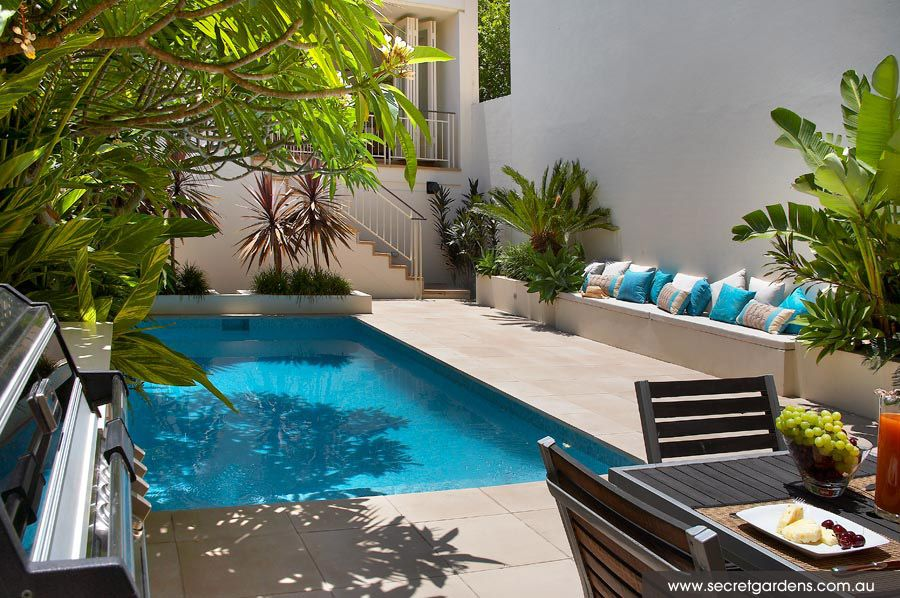 2 Small Backyard Ideas Designing Chic Outdoor Spaces with Swimming Pools is part of Courtyard garden Pool - These two small backyard ideas beautifully incorporate swimming pools into outdoors, creating gorgeous, functional, pleasant and chic outdoor living spaces with inviting small dining areas and miniature garden designs