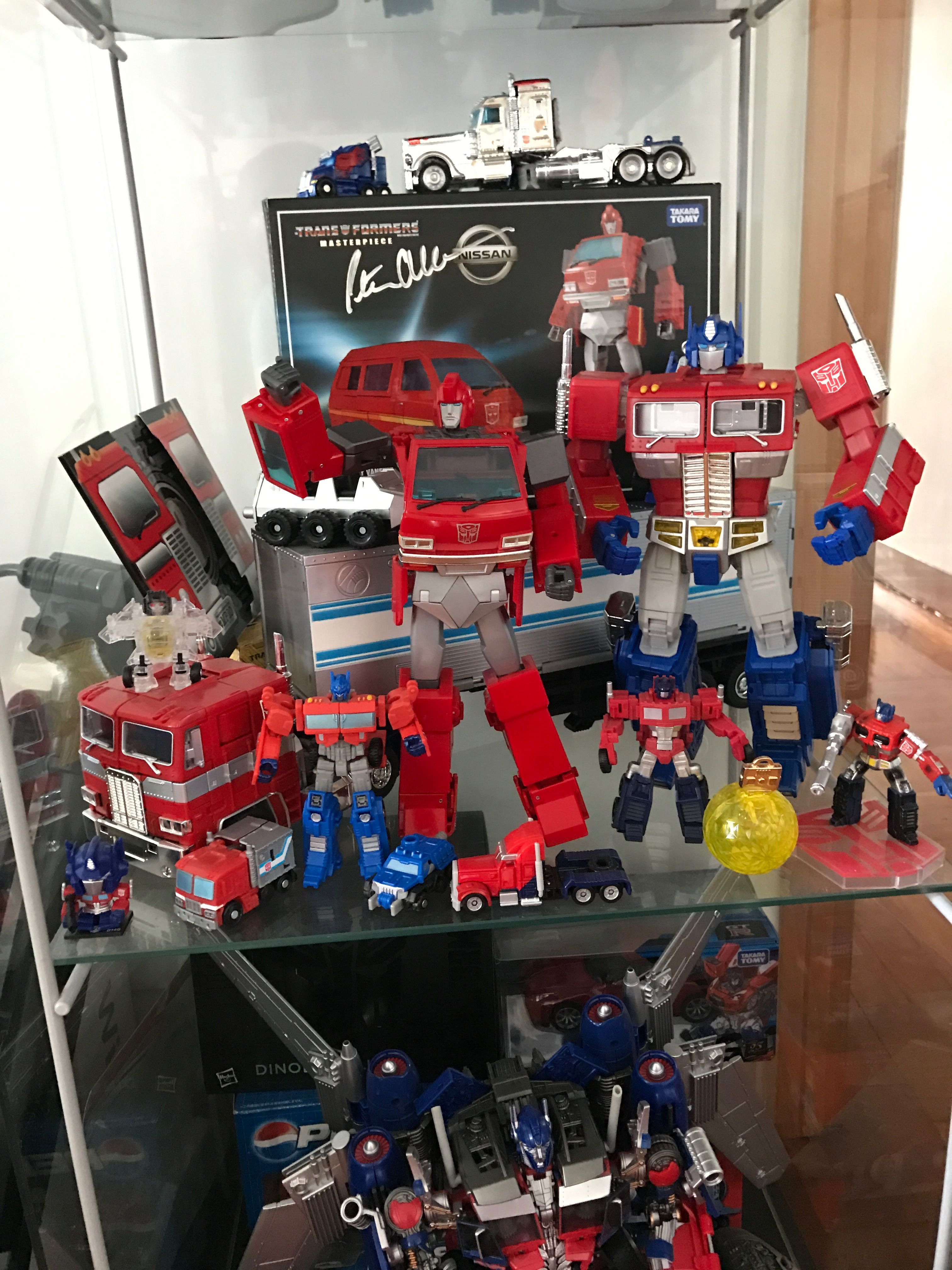One of the most cherished pieces in my collection - Ironhide autographed by Peter Cullen surrounded by more of my Primes - October 2016