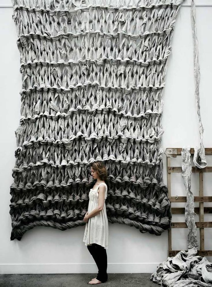 Crafter Jacqueline Fink of Little Dandelion knits unspun wool into remarkable throws and wall-hanging pieces featuring massive knitted stitches.
