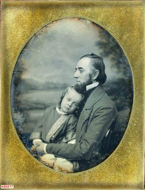 ca. 1850's, [melancholy daguerreotype portrait of a gentleman holding child], Samuel Broadbent