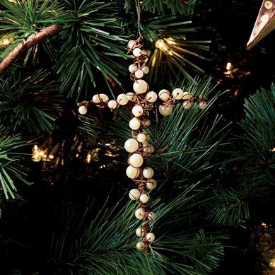 Remember what the holidays are really about this year. Give your tree a touch of true spirit with this beautifully handcrafted ornament made using the very finest imitation pearls. It's a standout piece you'll be proud to display in your home this season.