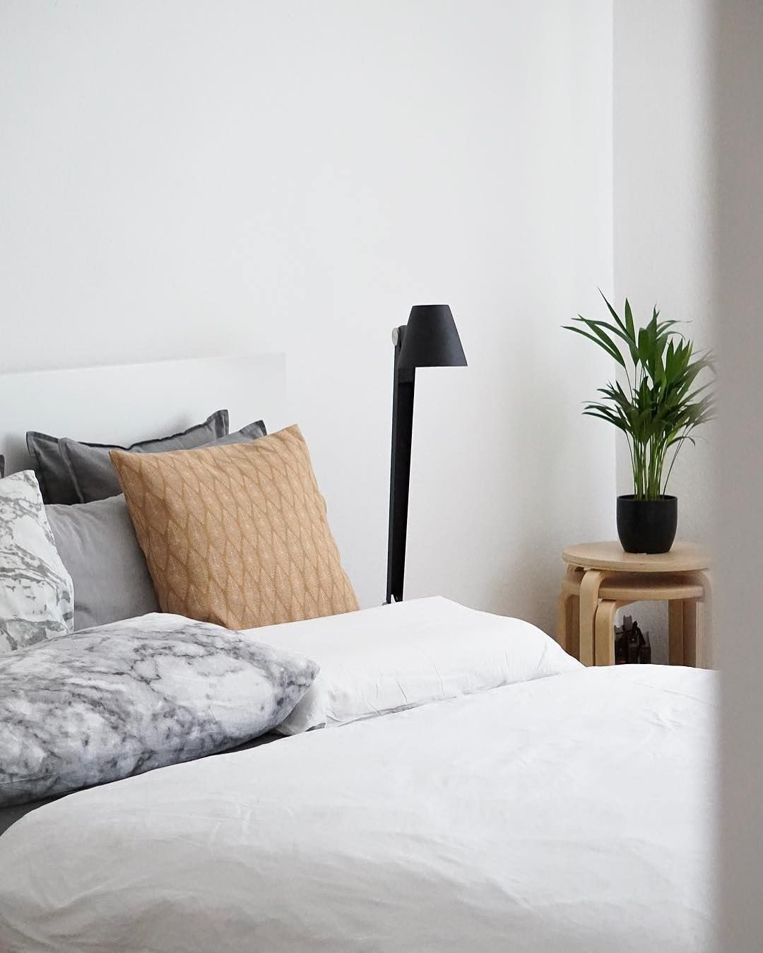 Master bedroom lighting  The Nordlux Cult table lamp standing tall in this cosy master