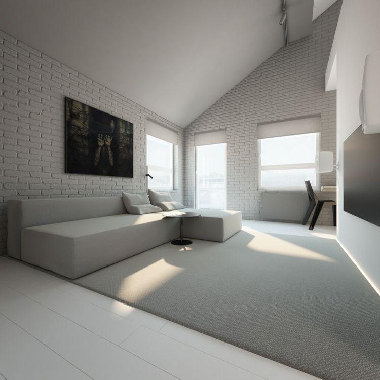 Wohnzimmer in Beige mit Backsteinwand und minimalistischem Couch