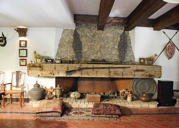 Indoor Fireplace Designs fireplace laced with antiques and collectables | stone fireplaces