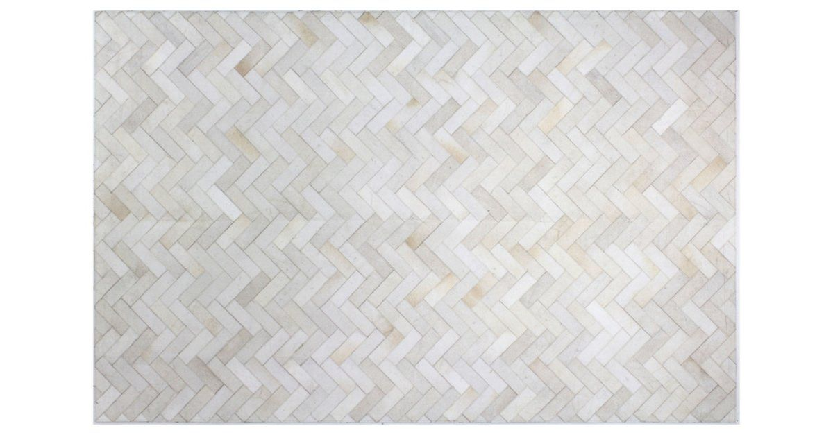 Give any room a beautifully textured foundation with this hand-stitched hide rug rendered in a versatile cream hue. A rug pad is recommended to keep this securely in place.